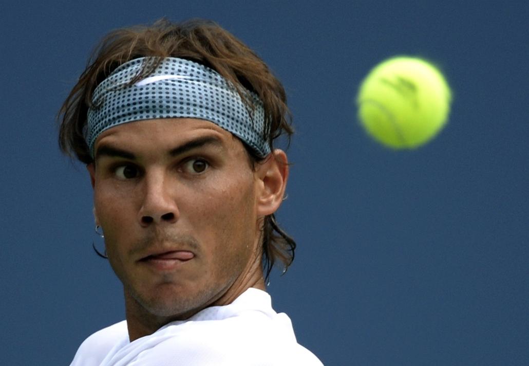 New York, Egyesült Államok: a spanyol Rafael Nadal az ameriaki Ryan Harris ellen vívott teniszmeccsén a US Open férfi egyesén. - 7képei