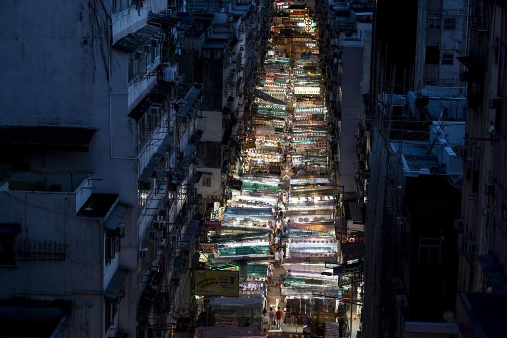 afp. hét képei - Hongkong, Kína, turisták, piac, 2014.08.26.